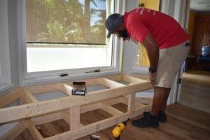 Man Measuring wall for Window Seat